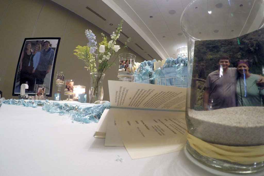 Personalized Table with Programs, Photos, and Decor